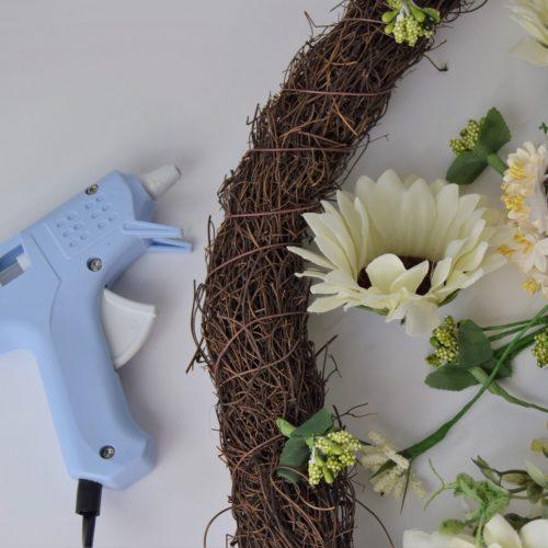 attaching flowers with glue gun