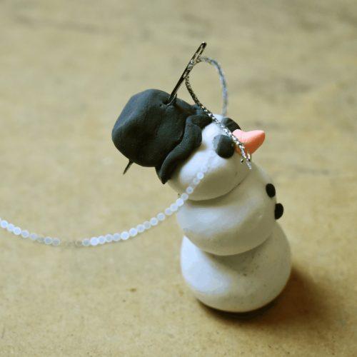 finishing clay snowman