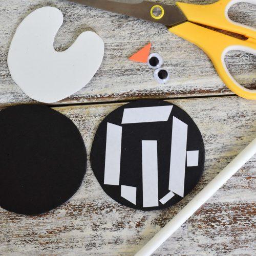 add double-sided tape to make foam penguin